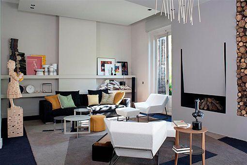 Un salón con cocina de diseño moderno