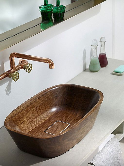 Natural and warm bathroom with wooden sink and bathtub