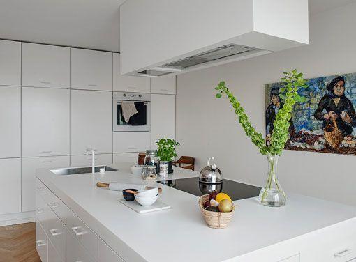 Reforma de un piso de 100 metros cuadrados amplio y luminoso - Cocina con isla central ...