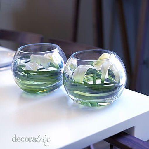 Jarrones de cristal con flores sumergidas for Jarron cristal decoracion