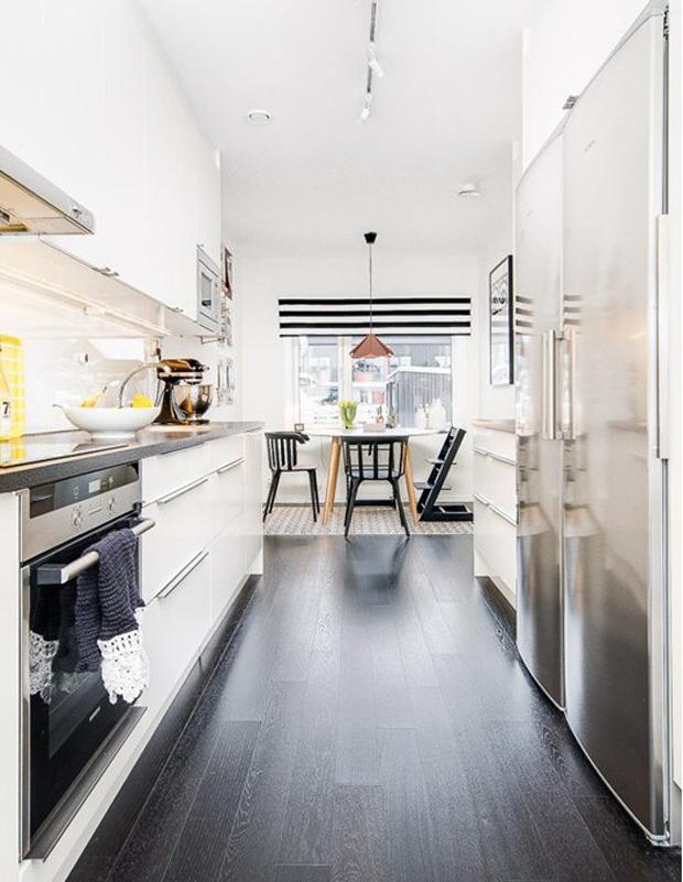 Cocina con comedor de diario y abierta al saln
